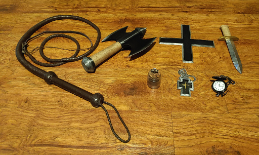 An assortment of medieval weapons and holy artifacts.